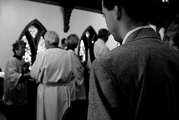 Young parishioner watching Rev. David Elliott