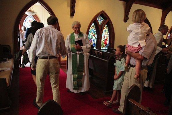 Rev. David Elliott greeting parishioners at St. Georges Episcopal Church in Clarksdale.