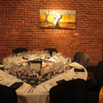 A table in the Dining Room at Madidi Restaurant for French Night Madidi. Photography by Langdon Clay