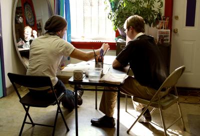 Gordon Gallery owner and artist Bradley Gordon working with art student Jason.