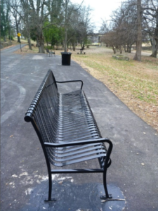 A bench along the Sunflower River in Clarksdale, Mississippi.