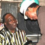 """Big T"" Williams talkin' to Alphonso Sanders during the party at Red's Club. Photo by The Delta Bohemian"