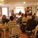 Author Curtis Wilkie talks to a crowd at TurnRow Book Company in Greenwood, MS. Photo by The Delta Bohemian
