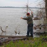 Poor William balancing on a log partially in the Mississippi River in the heart of the Mississippi Delta. Photo by The Delta Bohemian