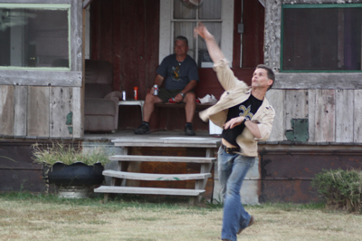 Artist Randall Andrews throwing the football at the Shack Up Inn near Clarksdale, MS. Photo by The Delta Bohemian