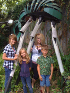 Howell children under Bill and Francine Luckett's Boll Weevil. Photo by DB