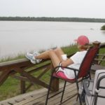DB Becky watching the Mississippi River. The water is now almost covering this porch. Photo by The Delta Bohemian