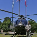 Chief Warrant Officer Bo Barrett of Tupelo next to a UH 72 Lacota at Delta Council in Cleveland, MS. Photo by The Delta Bohemian