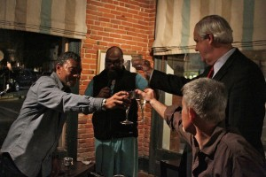 Dr. Alphonso Sanders, Dr. Derrick Miles, Musician Stan Street and Bill Luckett toasting. Photo by Delta Bohemian
