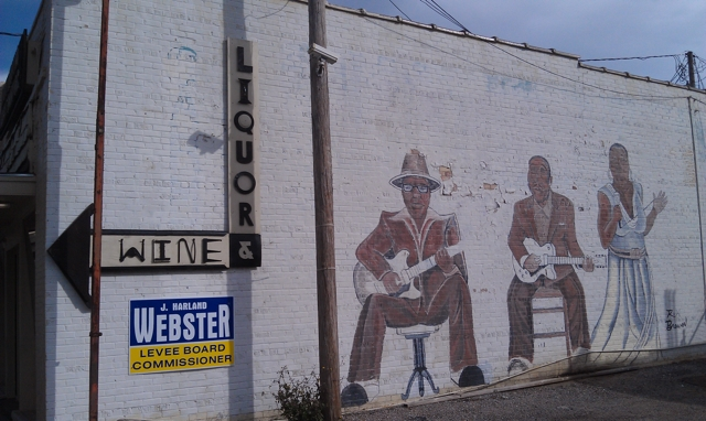 Downtown Wine and Liquor sign on side of building in Clarksdale. Photo and signage by Delta Debris.