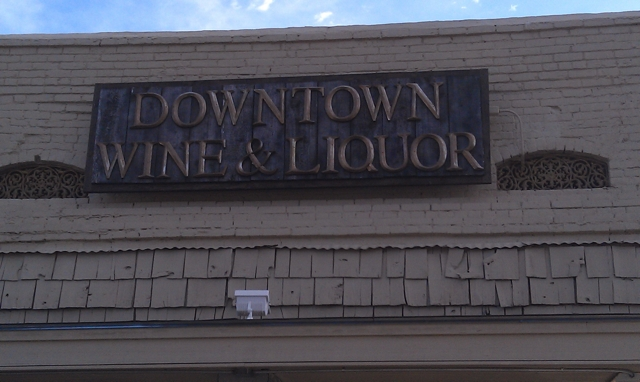 Downtown Wine and Liquor sign in Clarksdale. Photo and signage by Delta Debris.