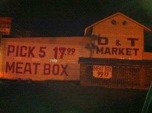 Signs on corner of State Street and Sunflower Avenue in Clarksdale. Photo by Delta Bohemian