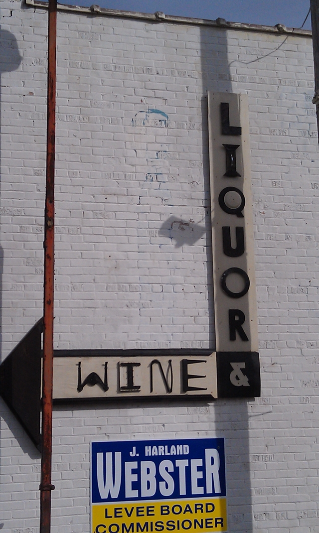 Clarksdale Downtown Wine and Liquor signage on side of building in Clarksdale. Photo and signage by Delta Debris