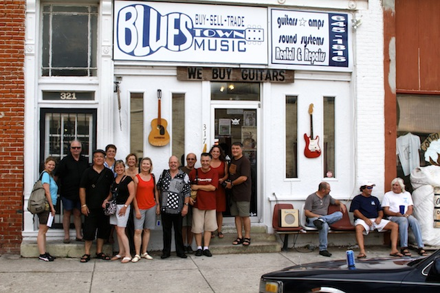 A group of French tourists in front of Bluestown, owned by Ronnie Drew, in Clarksdale. Ronnie is on the far right. Photo by DELTA BOHEMIAN