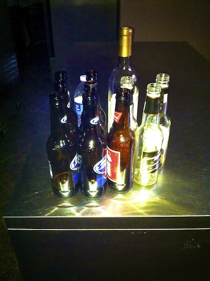 Empty Beer Bottles left in the kitchen by the British Guests at Clark House. Photo by DELTA BOHEMIAN