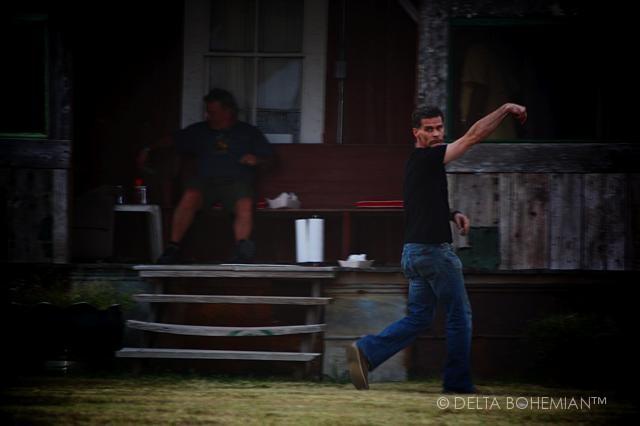 Delta Debris Artist Randall Andrews throwing the pigskin at Shack Up Inn near Clarksdale.