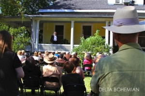 Actor Johnny McPhail performing on a porch during Tennessee Williams Festival in Clarksdale.