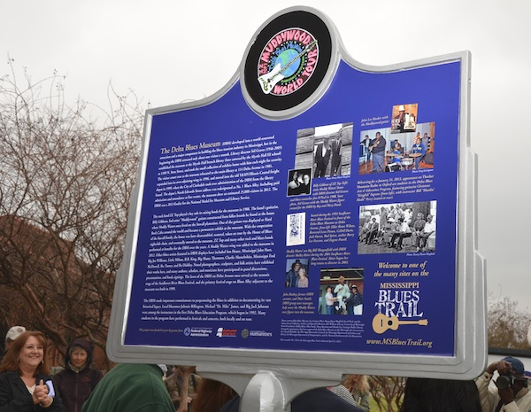 The back of the Delta Blues Museum marker features a colorful logo of the Muddywood guitar, a gift to the Delta Blues Museum by rock stars ZZ Top in 1988, and historical photographs of the museum. Photo by Panny Mayfield