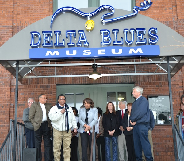 (from left) Wayne Winter, president of the Coahoma County Tourism Commission; Clarksdale Mayor Henry Espy; Coahoma County Supervisor Johnny Newson and his wife, Wilhelmina  Newson; Shelley Ritter, museum director; Bill Gresham , president of the museum's board of trustees; Kappi Allen, director of Coahoma County Tourism; and Paul Pearson, Coahoma County Supervisor. Photo by Panny Mayfield