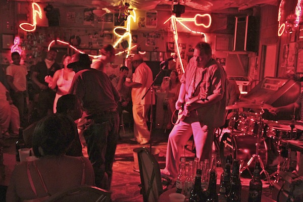 Lightnin' Malcolm with Pinetop Perkins making his way across the dance floor. Photo by DELTA BOHEMIAN