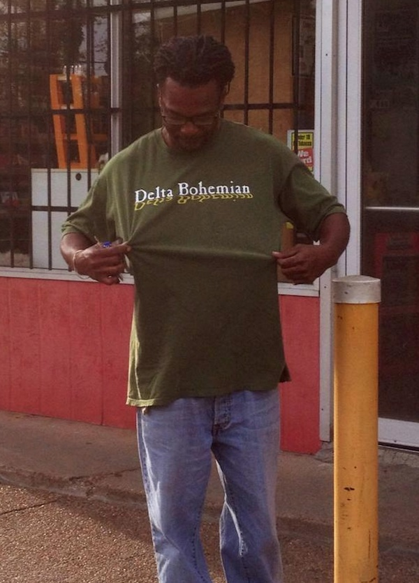 Jerry McCray, owner of Jerry's Dreamboat BBQ, shown sporting a Delta Bohemian T-Shirt in front of Corner Grocery in Clarksdale.