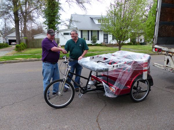 Darrel and Billy shake hands over safe delivery of our pedicab