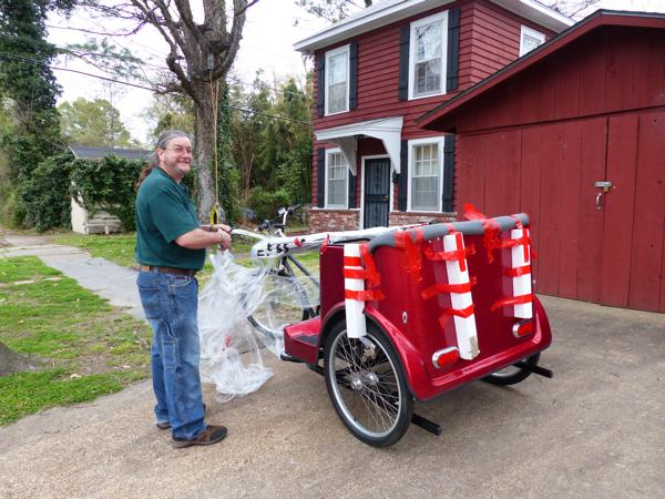 Poor William unwrapping the Delta Bohemian Excursions pedicab