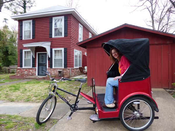 Magical Madge in front of the Delta Bohemian Guest House in the DB pedicab