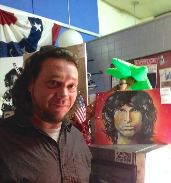 Local Artist Tommy Walton at Bluesberry Cafe in Clarksdale with his painting of Morrison