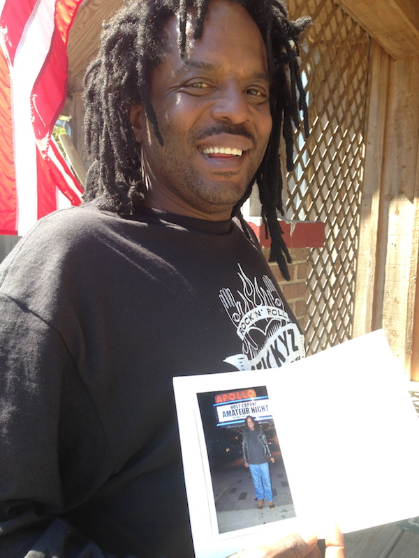 Lucious Spiller with his momento from NYC  ©2014 DELTA BOHEMIAN
