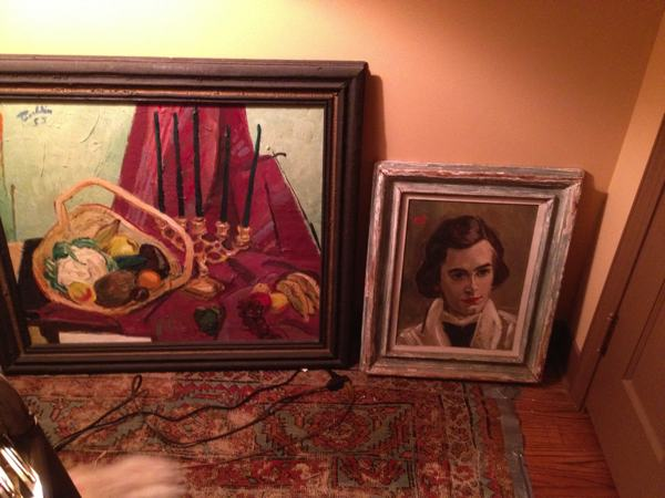 An early still life and a painting of his beloved wife Mel by Marshall Bouldin III leaning against the wall in his bedroom.