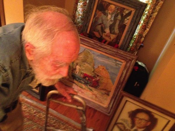 Artist Marshall Bouldin III surrounded by his early works in his bedroom.