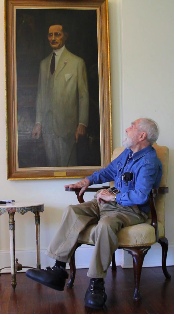 Artist Marshall Bouldin III admiring his Grandfather in the first commissioned portrait the painter ever painted.