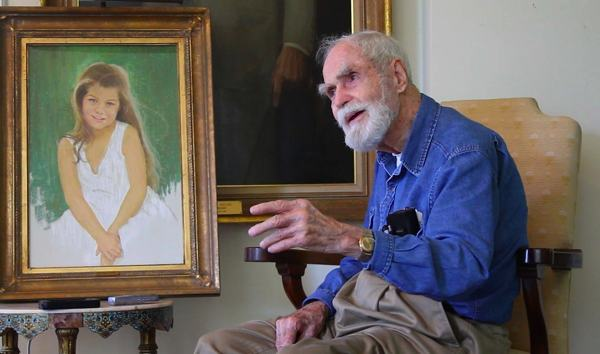 Artist Marshall Bouldin III next to a pastel portrait he painted of cousin Corinne Vance