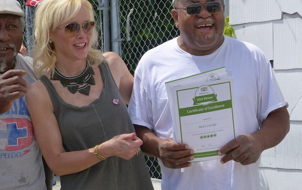 Red Paden showing off his tripadvisor award with Dr. Dingo and Melissa Townsend