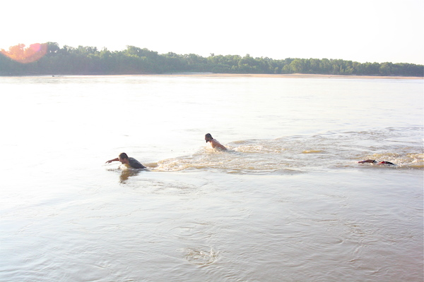 Mr. Lil John, Driftwood Johnnie and Poor William swimming in the Mississippi River