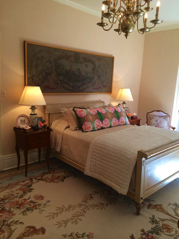 A bedroom with premium antiques in Mary Helen McCoy's home gallery. Kim Duease fabric on pillow.
