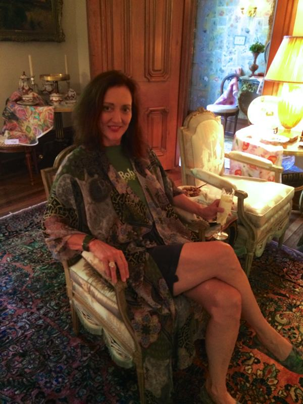 Magical Madge sitting in one of two Louis XVI period chairs attributed to chair maker Sené.