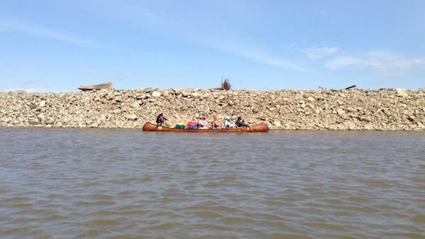 Mark River Peoples guides a canoe with paddlers on the Mississippi River