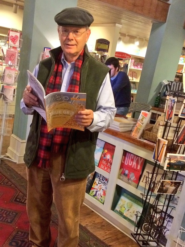Greenwood native Bryan Lott holding the newest issue of The 'Sip at TurnRow Bookstore in Greenwood