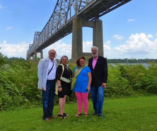 Helena Mayor Jay Hollowell, Marilyn Trainor Storey, Coahoma Country Director of Tourism Kappi Allen, Clarksdale Mayor Bill Luckett standing under the Helena Bridge