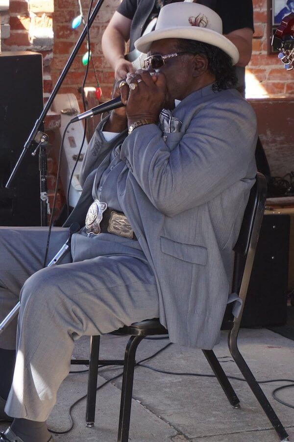 Big George Brock playing in front of Cat Head in Clarksdale. Photo by Andrea Vlonk