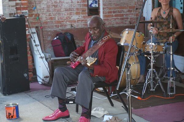 "Leo ""Bud"" Welch playing in front of Cat Head in Clarksdale. Photo by Andrea Vlonk"