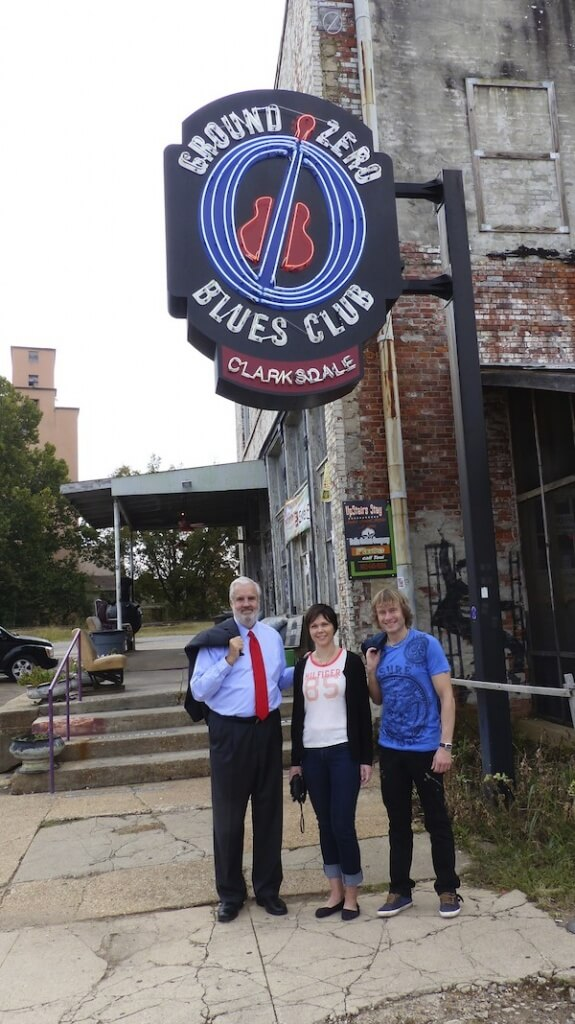 Mayor Bill Luckett with two visitors from Finland in front of Ground Zero in Clarksdale