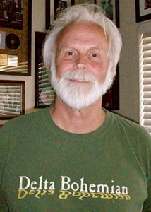 Bill Bowker wearing a Delta Bohemian First Edition green t-shirt