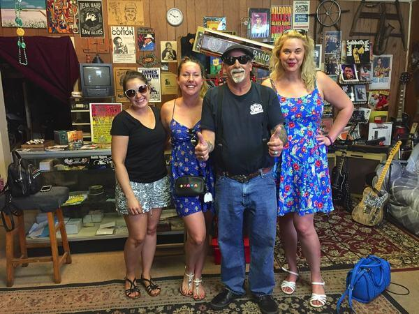 Deak Harp with the bride and her friends at his shop in Clarksdale after he gave them an impromptu performance