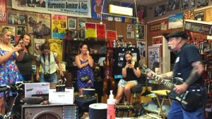 Deak Harp performing for visitors to his shop in Clarksdale