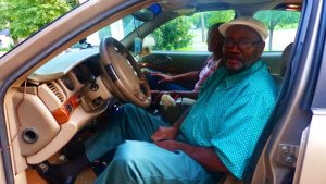 Clarksdale Taxi Cab Driver Roosevelt Noah waiting on his fare ride at the Clarksdale White House