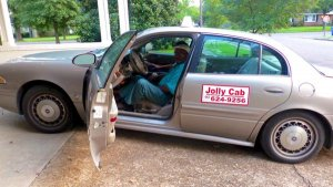 Cab Driver Roosevelt Noah's Jolly Cab arriving at the Clarksdale White House