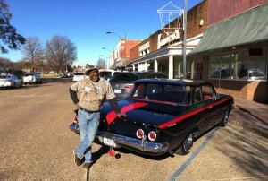 Big J Milton Johnson owner of Johnson Plumbing in Cleveland, Mississippi by his Chevy 1961 Bel Air